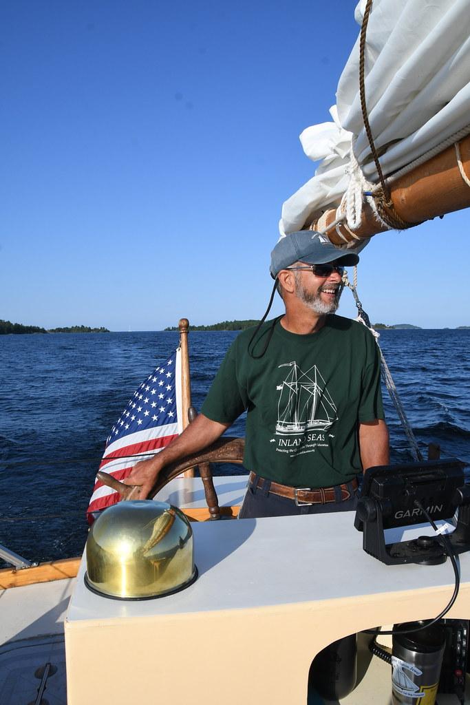Captain Hugh at the Helm of the Schooner Huron Jewel